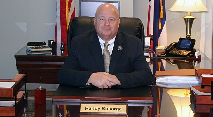 Randy Borsage sitting behind desk