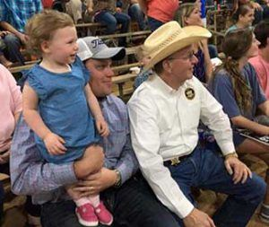 Sheriff and a Family at a Rodeo